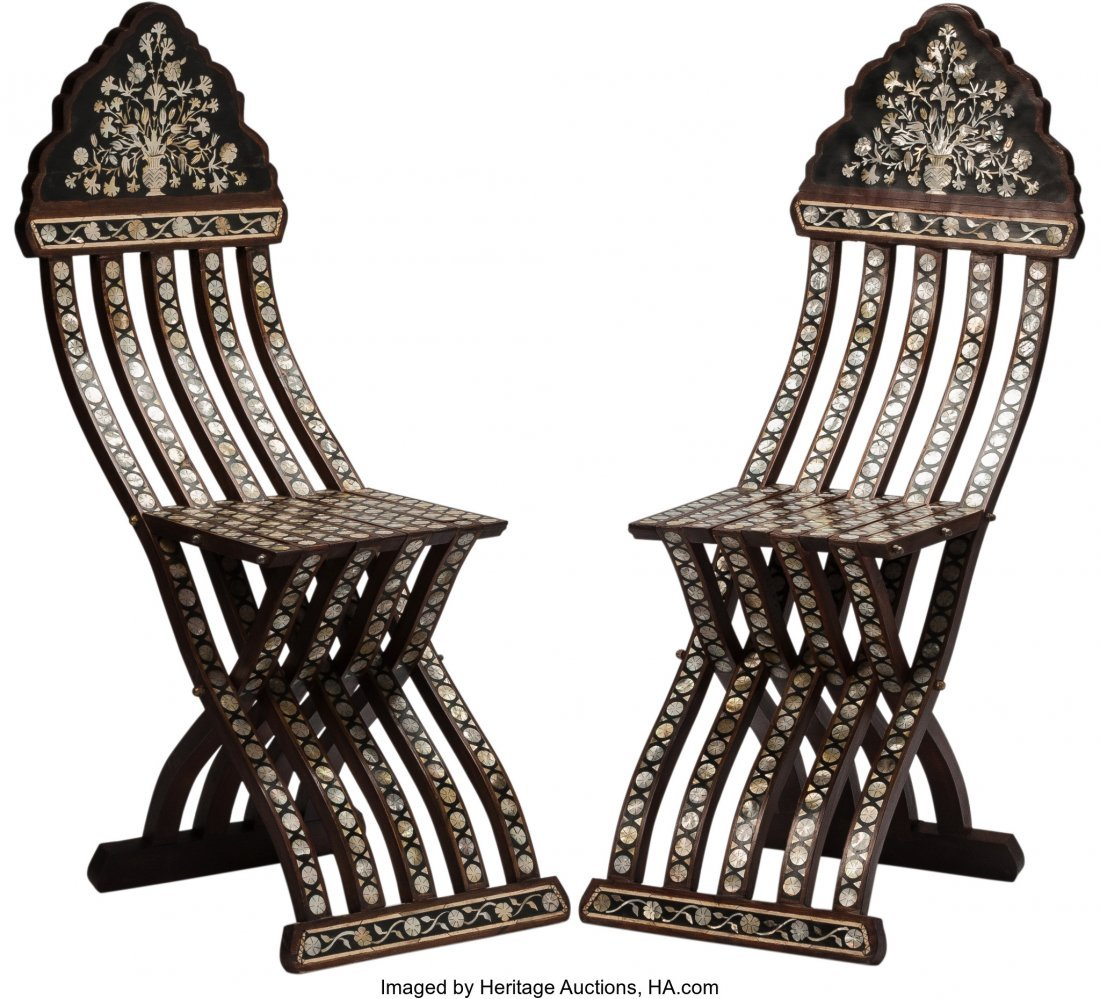 63451: A Pair of Moorish Folding Side Chairs 42 h x 13