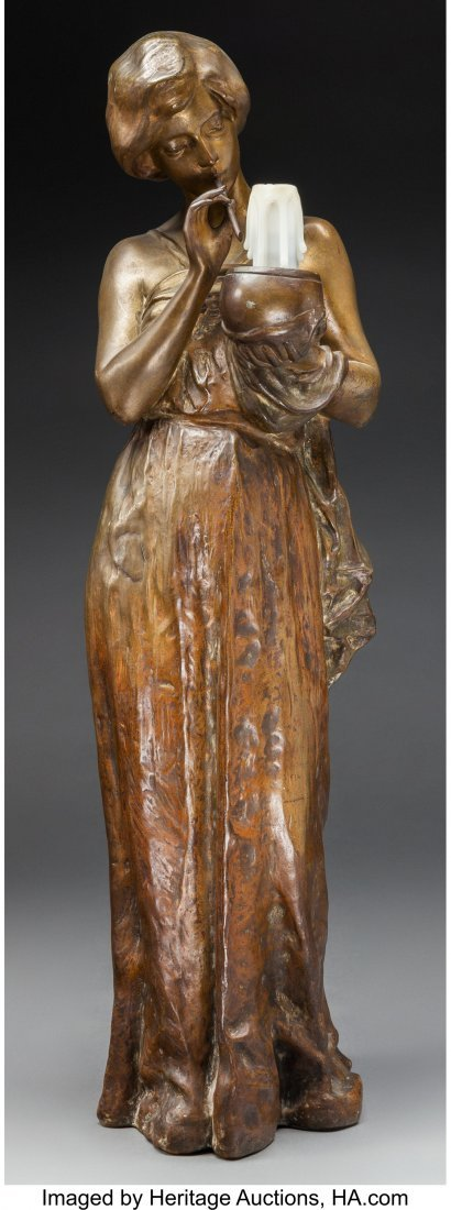 63706: A Large Bronze Figure of a Woman Holding a Candl