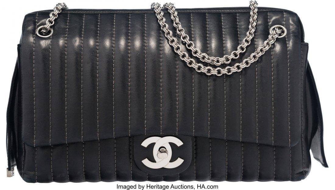 58021: Chanel Black Lambskin Mademoiselle Maxi Flap Cam