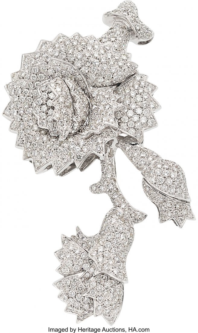 55177: Diamond, White Gold Brooch  The floral brooch fe
