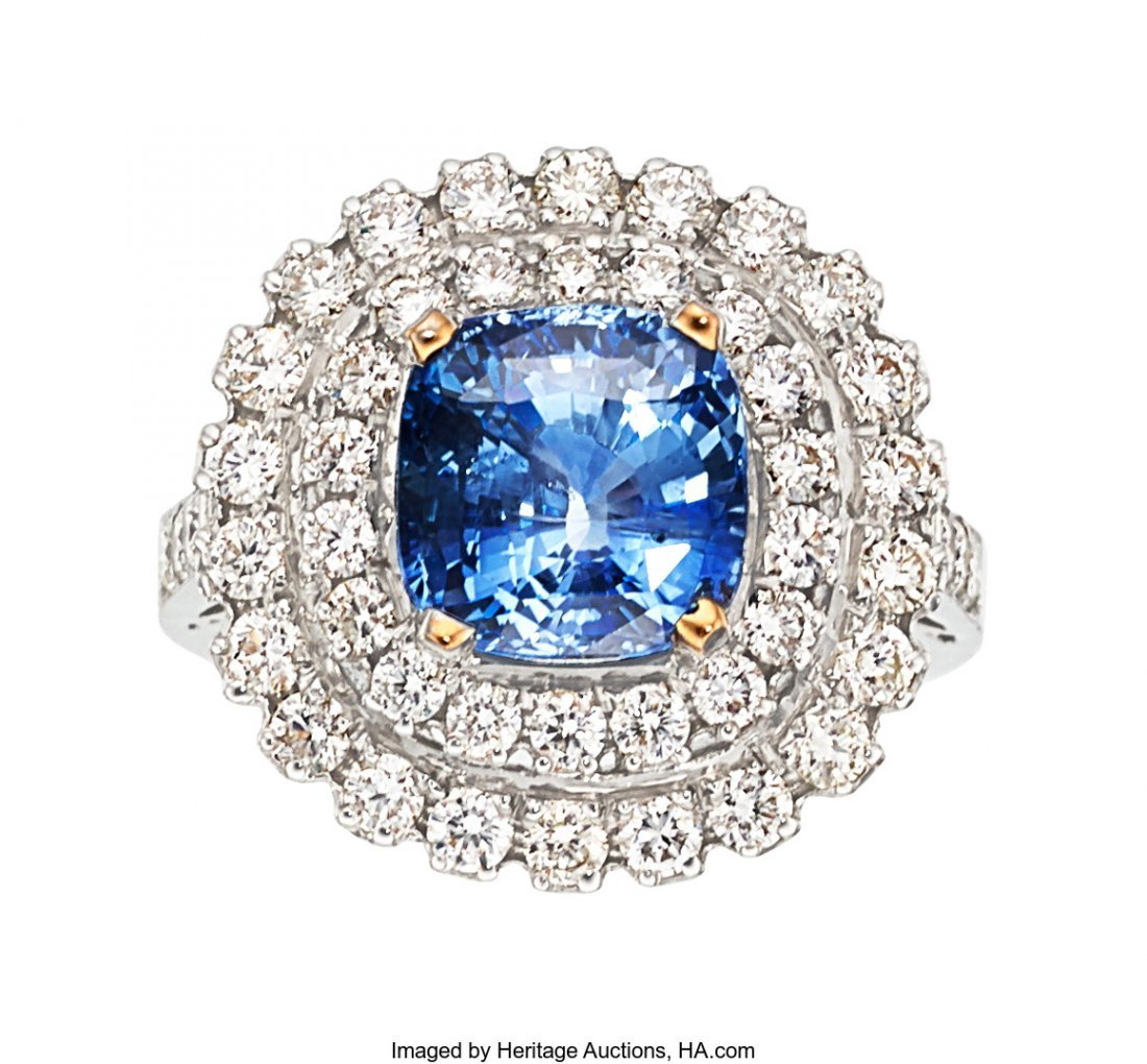 55090: Sapphire, Diamond, White Gold Ring  The ring fea