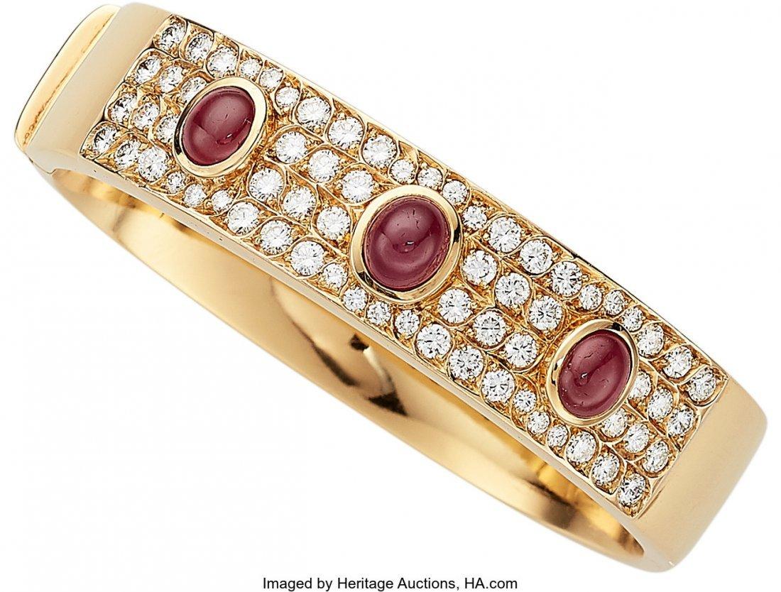 55281: Diamond, Ruby, Gold Bracelet  The hinged bangle