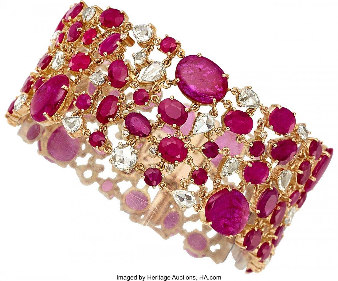 55113: Ruby, Diamond, Gold Bracelet  The bracelet featu