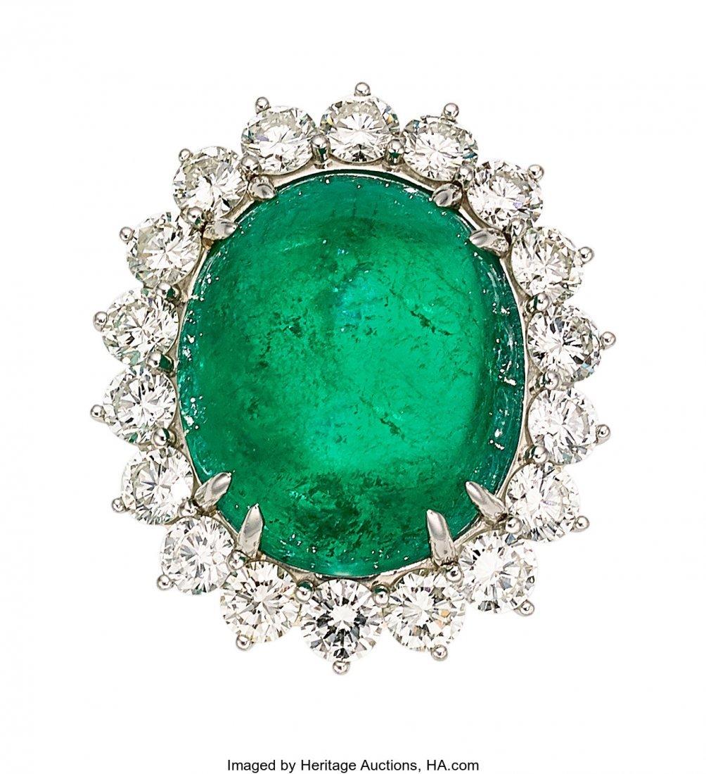 55285: Emerald, Diamond, Platinum Ring  The ring featur