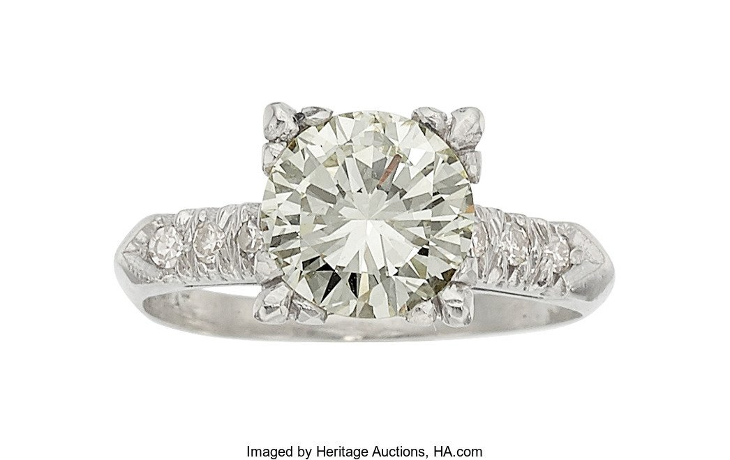 55202: Diamond, Platinum Ring   The ring features a rou