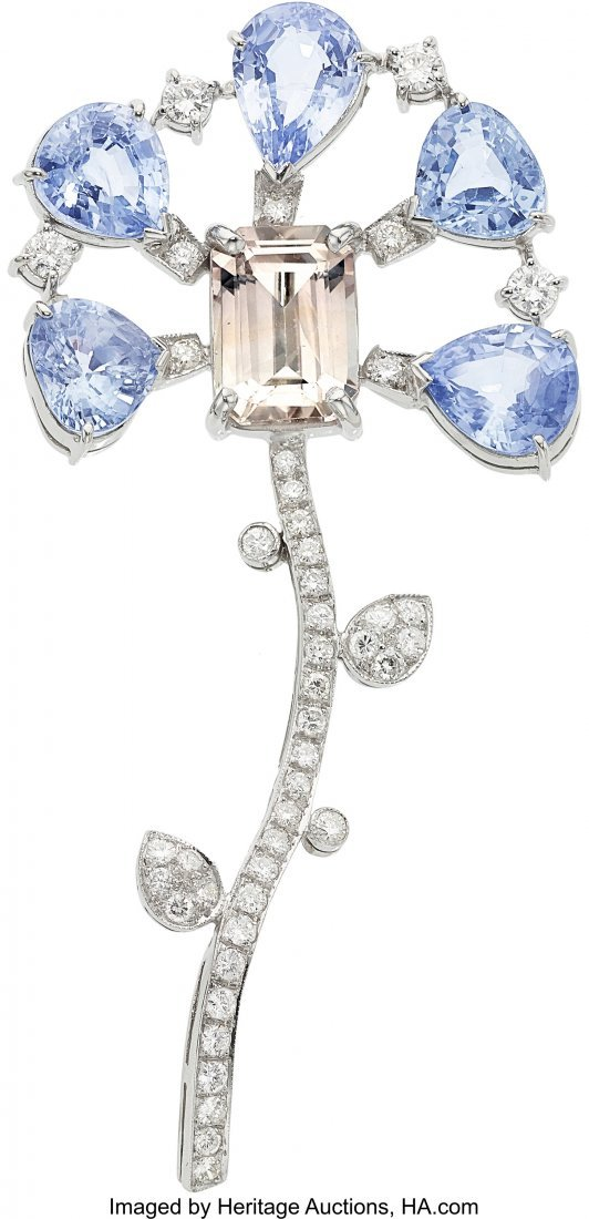 55303: Sapphire, Diamond, Platinum Brooch  The flower b