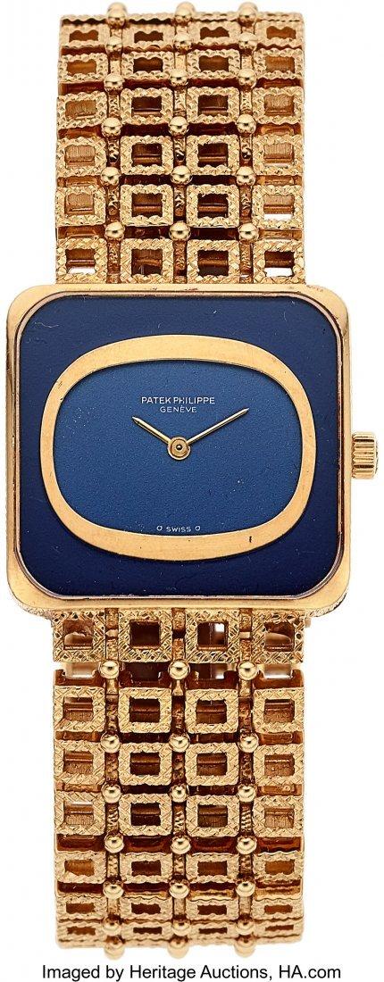 55127: Patek Philippe Lady's Lapis Lazuli, Gold Watch