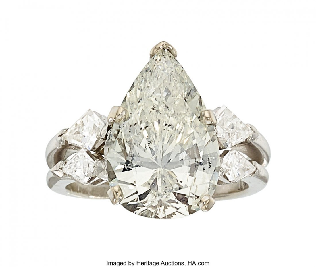 55216: Diamond, Platinum Ring  The ring centers a pear-