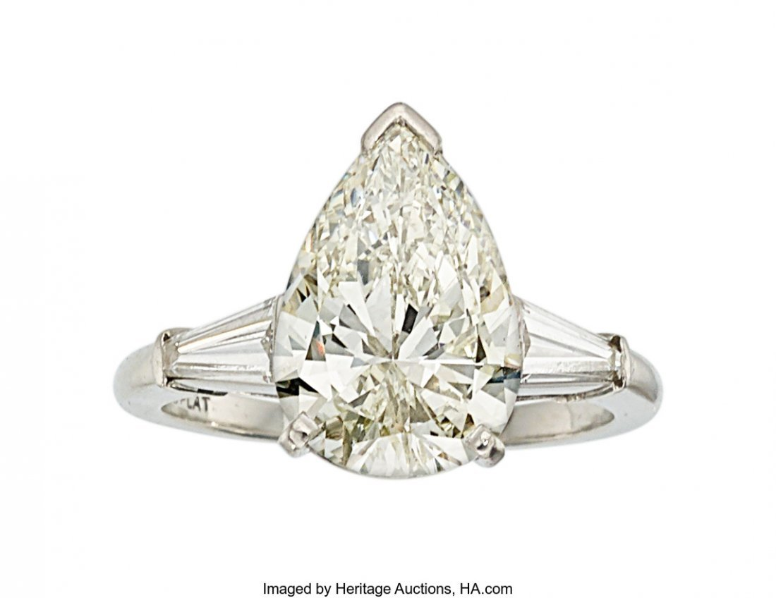 55221: Diamond, Platinum Ring  The ring features a pear