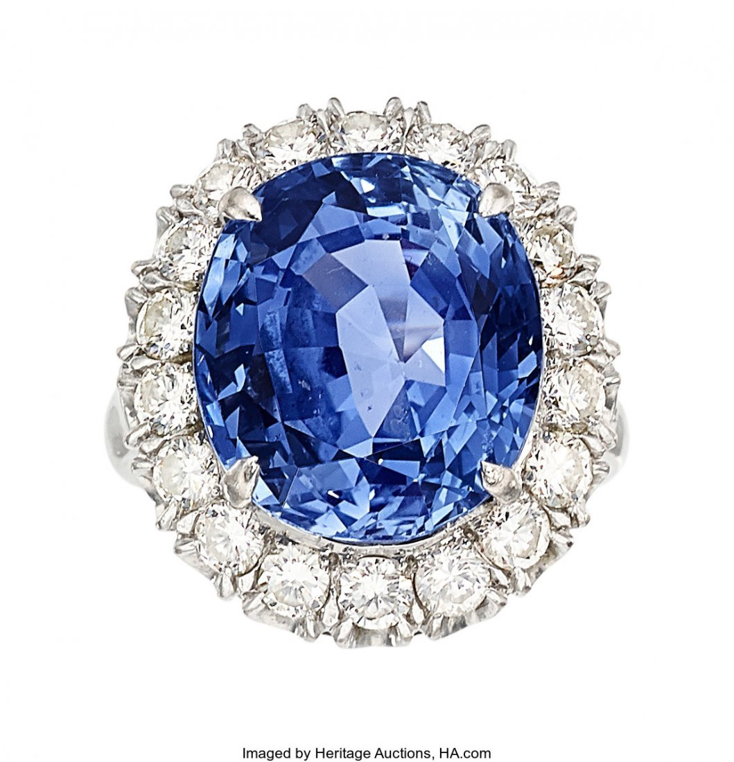 55136: Sapphire, Diamond, White Gold Ring  The ring fea