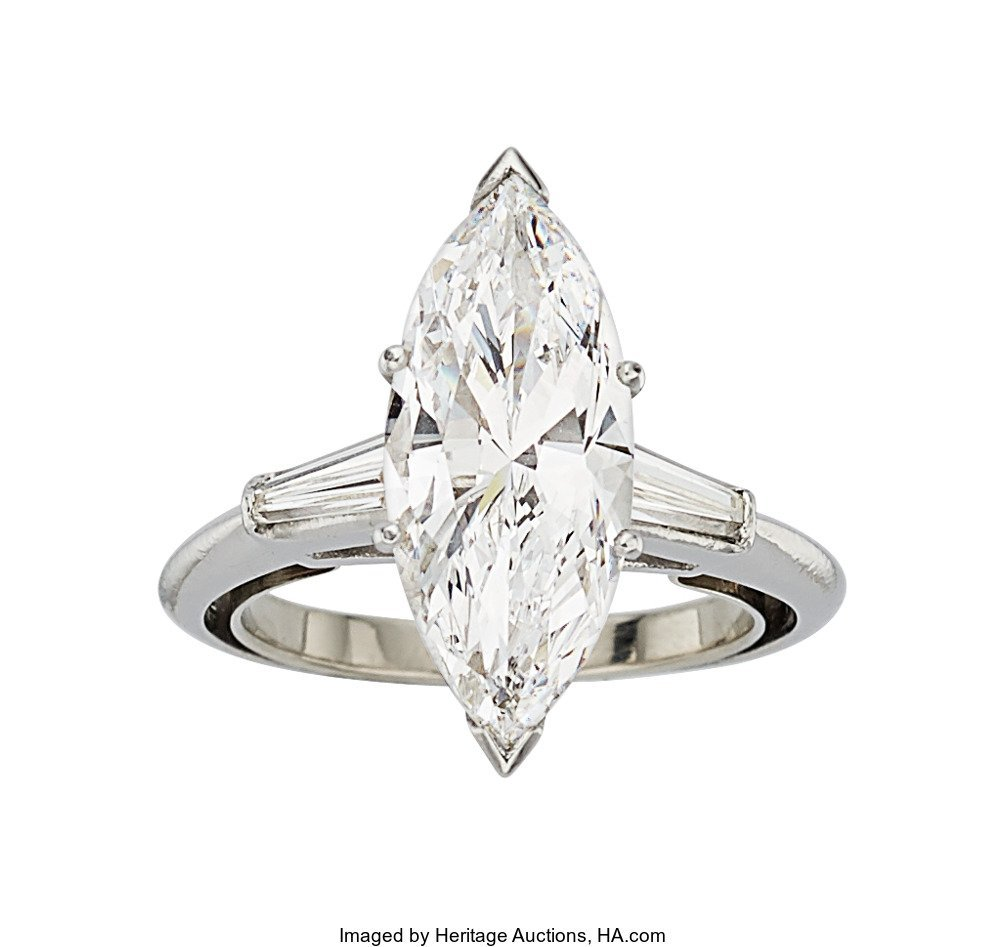 55320: Diamond, Platinum Ring  The ring features a marq