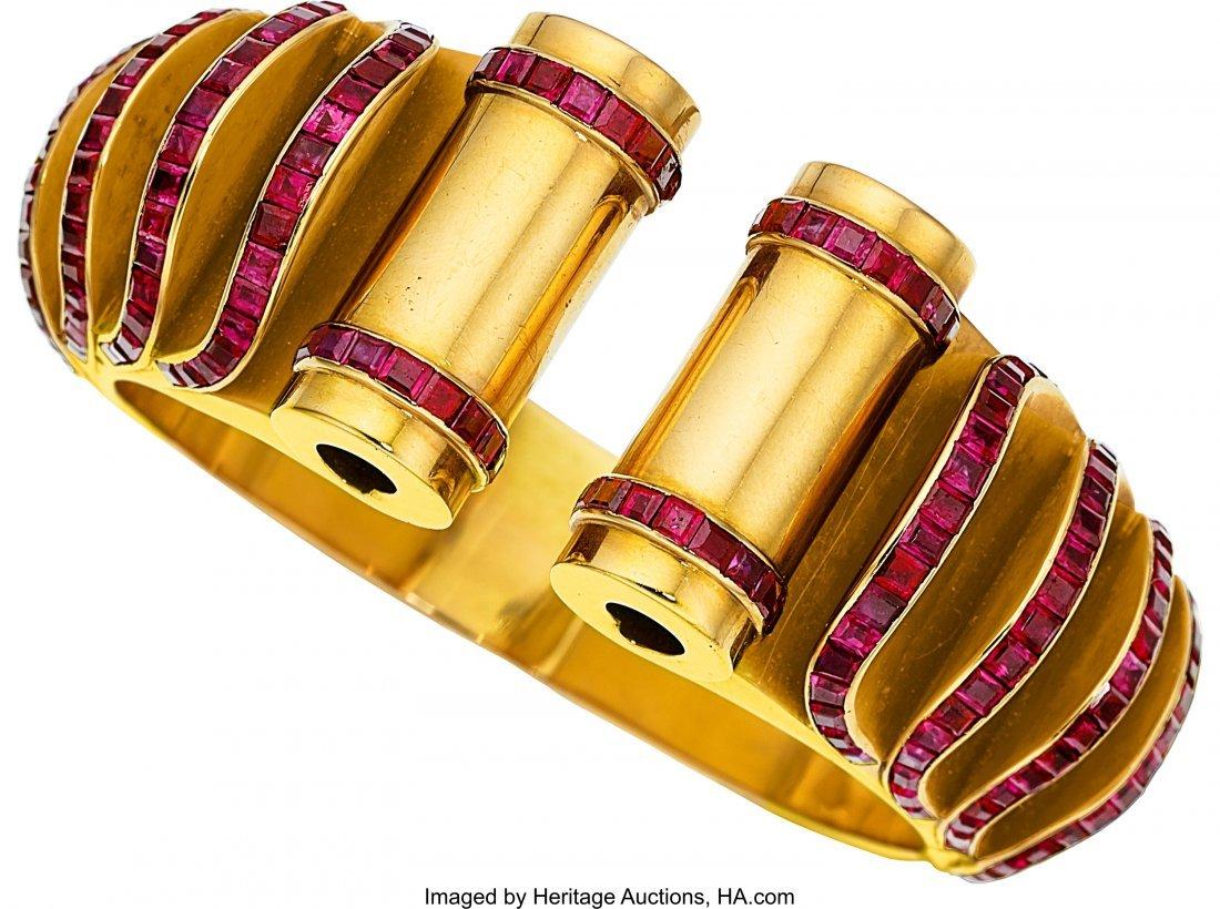55229: Retro Ruby, Gold Bracelet  The hinged cuff featu