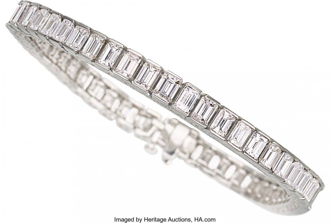 55242: Diamond, Platinum Bracelet   The bracelet featur