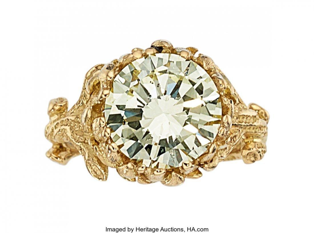 55244: Diamond, Gold Ring, Julius Cohen  The ring featu