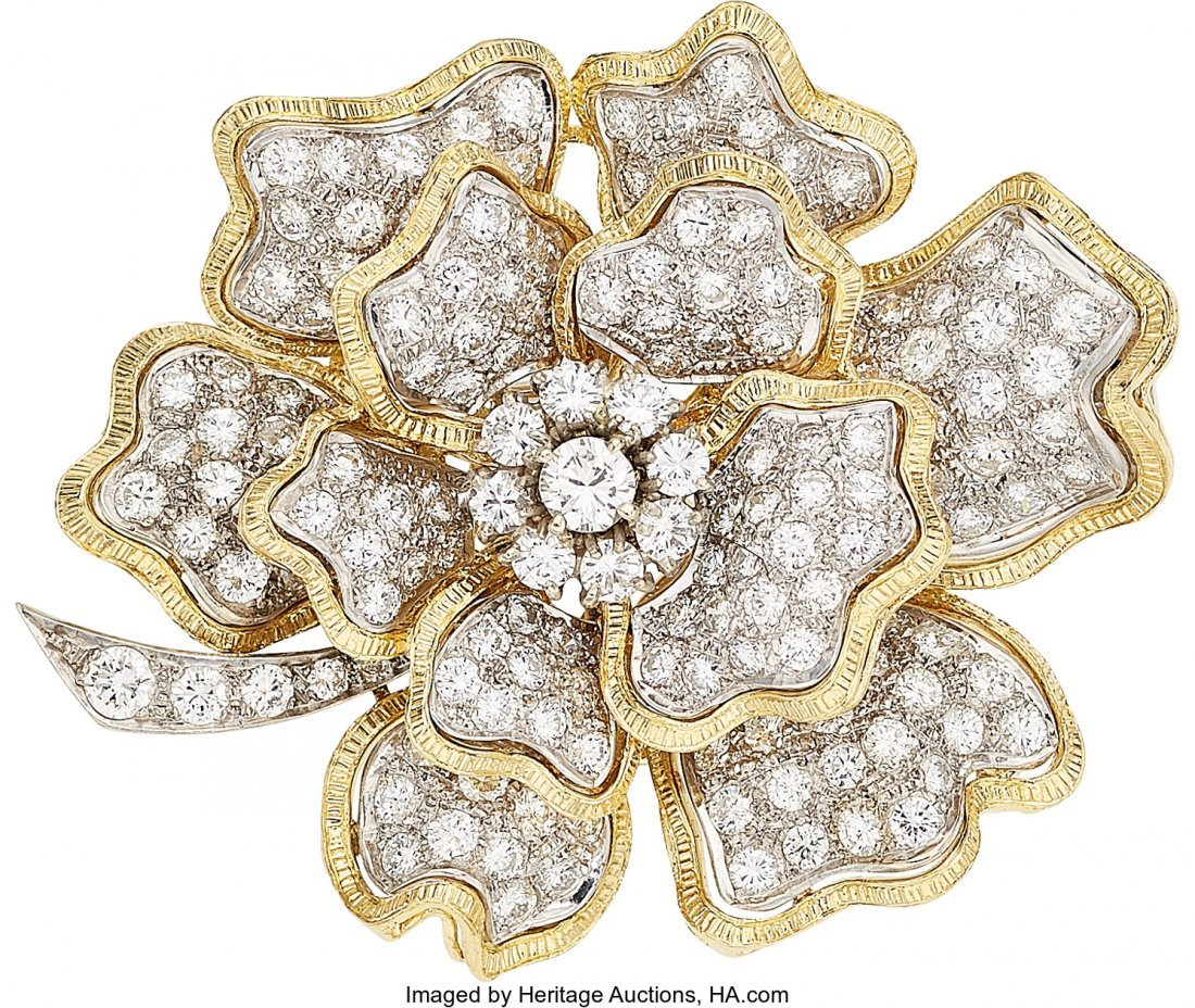 55246: Diamond, Gold Brooch  The brooch features a roun