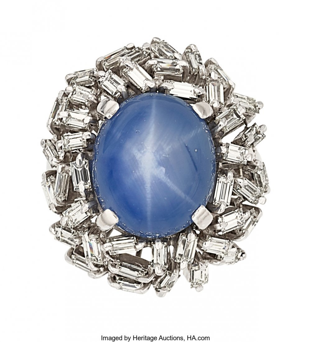 55247: Star Sapphire, Diamond, White Gold Ring  The rin