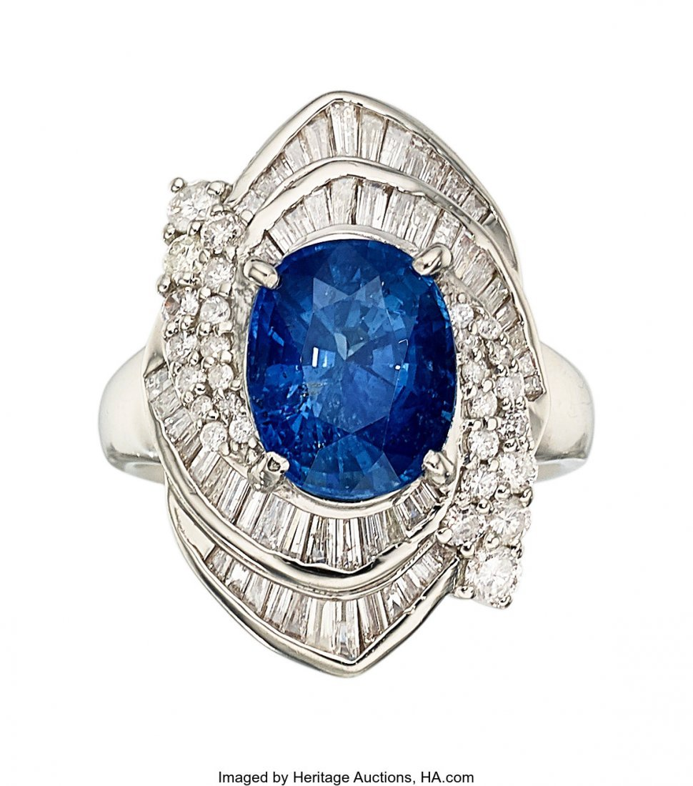 55341: Sapphire, Diamond, Platinum Ring  The ring featu