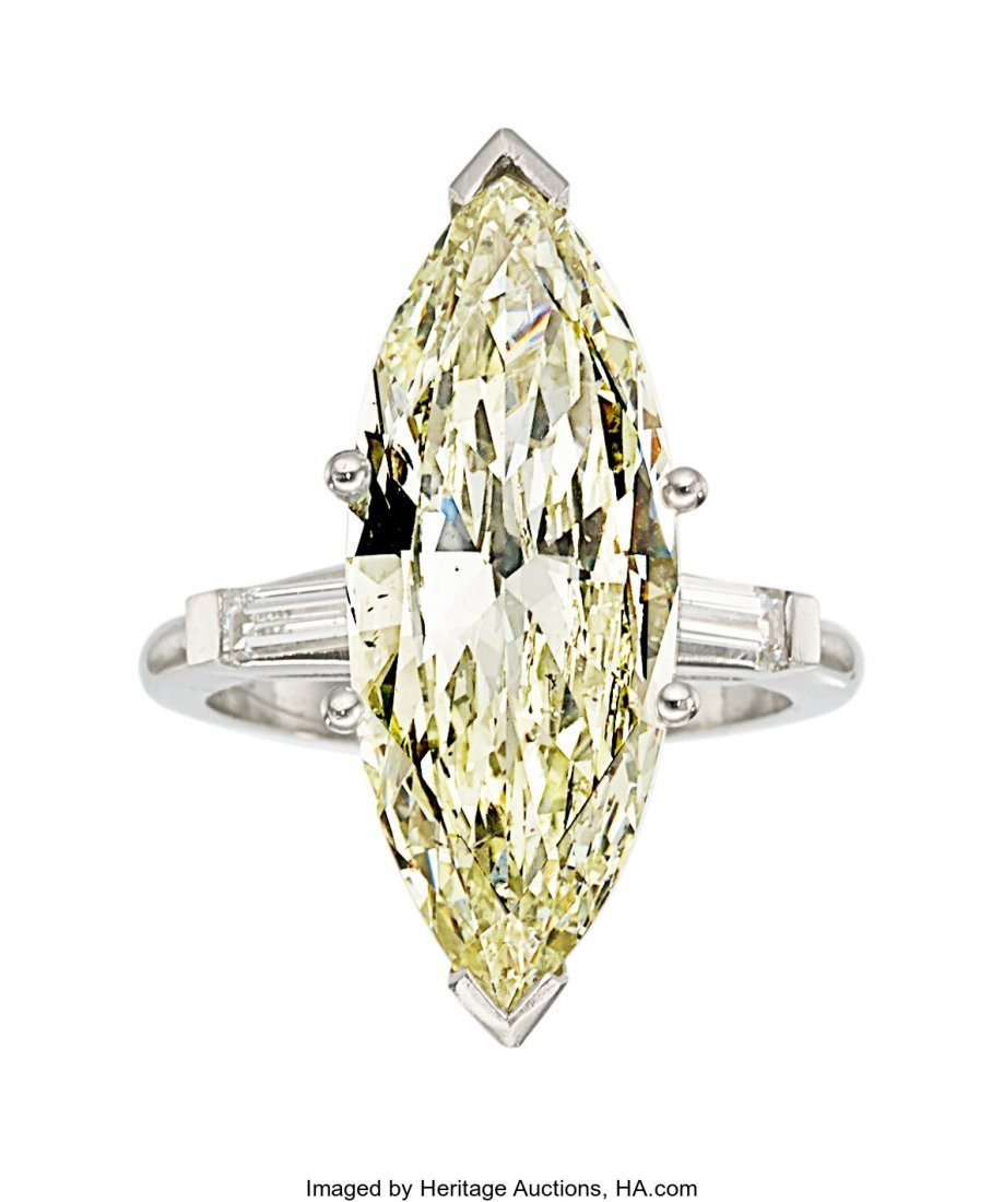 55253: Diamond, Platinum Ring   The ring features a mar