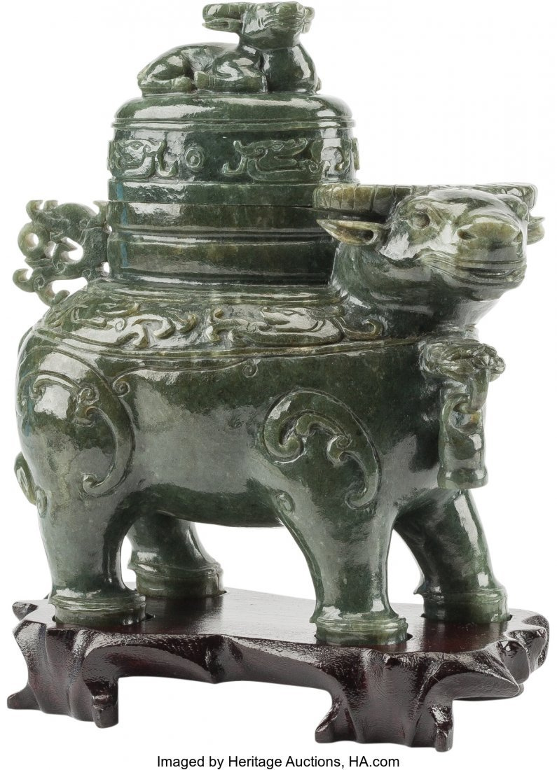 61257: A Chinese Carved Spinach Jade Figural Ox Censer