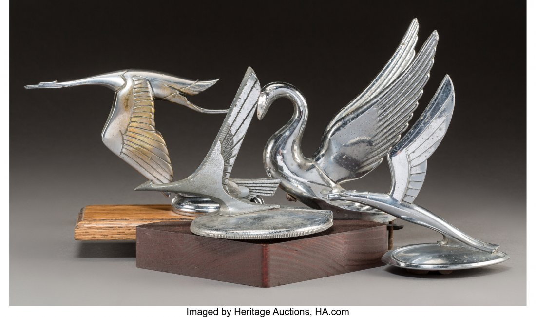 61957: Four American and Spanish Chromed Bird Automobil