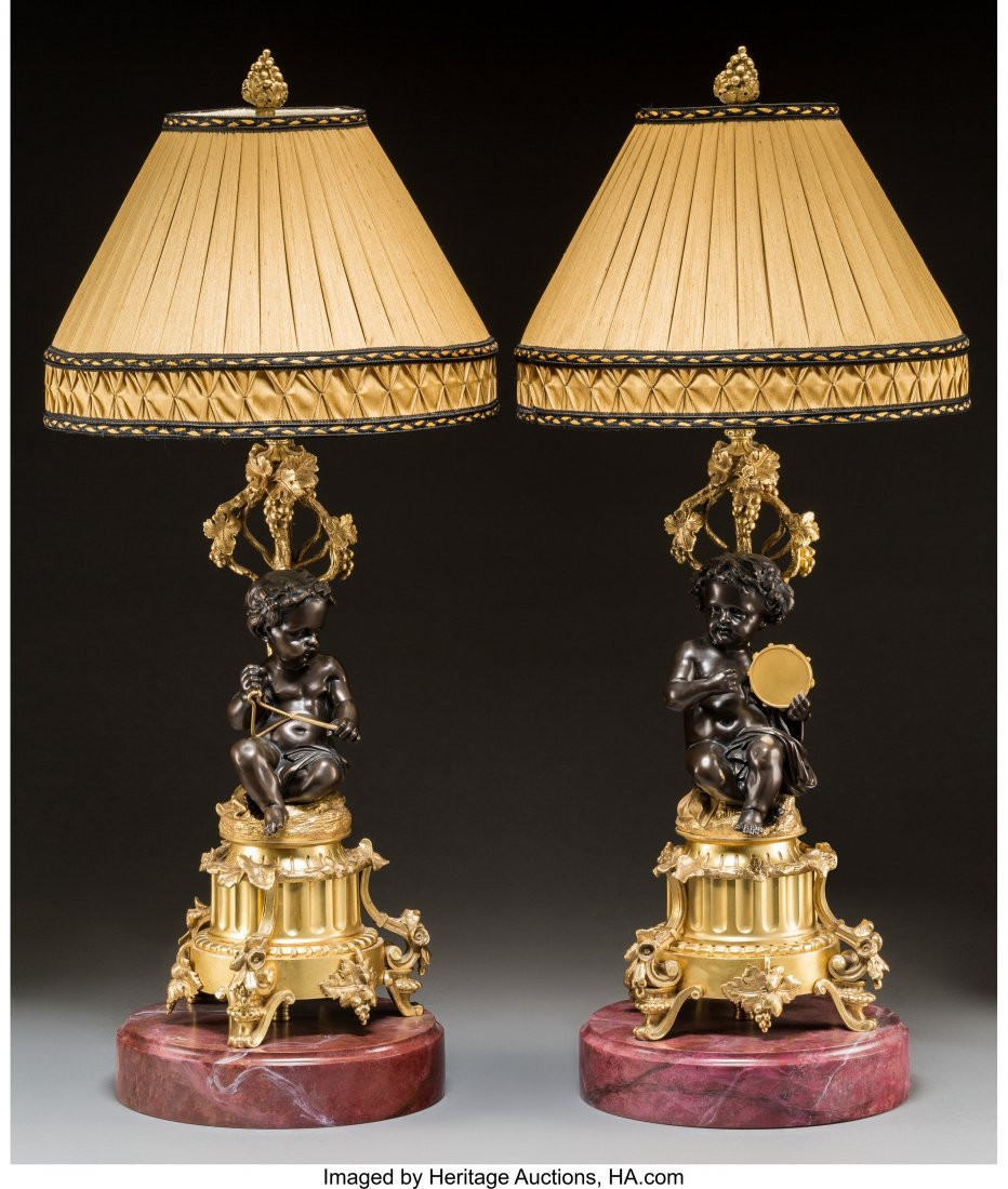 61778: A Pair of Gilt and Patinated Bronze Putti Lamps