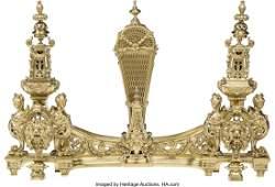 A Four-Piece Louis XV-Style Brass Fireplace Set