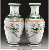 78373 A Pair of Chinese Enameled Porcelain Parrots wit