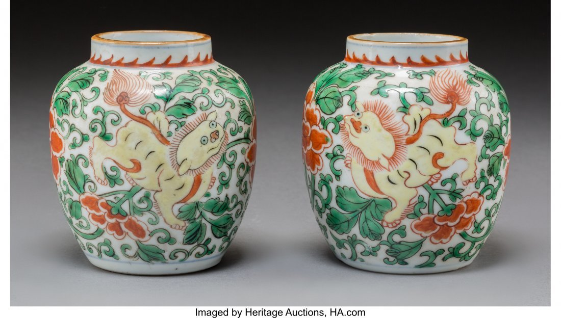 78301: A Pair of Chinese Wucai Porcelain Jars with Lion