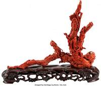 78120: A Chinese Carved Coral Figural Group on Hardwood