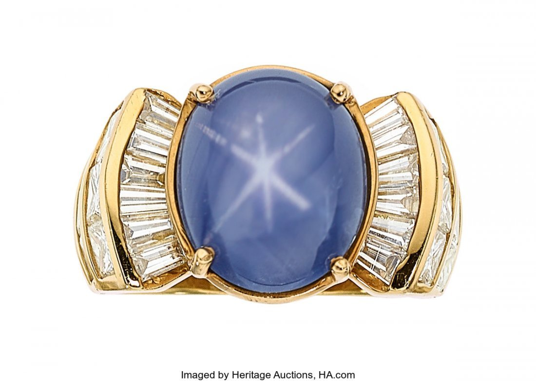 55386: Star Sapphire, Diamond, Gold Ring   The ring fea