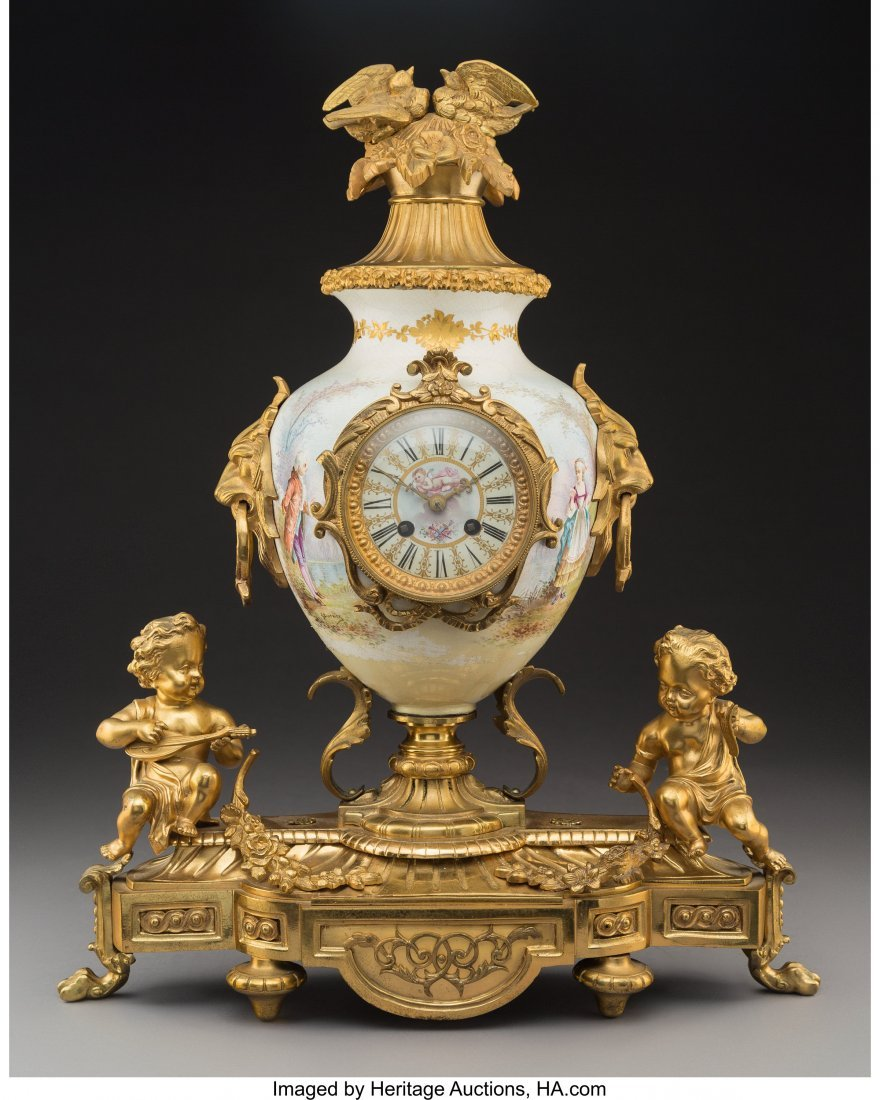63541: A French Porcelain Mantel Clock with Figural Gil