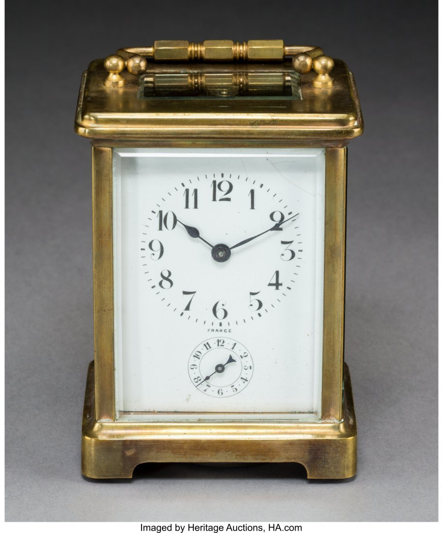 64074: A French Brass and Beveled Glass Carriage Clock