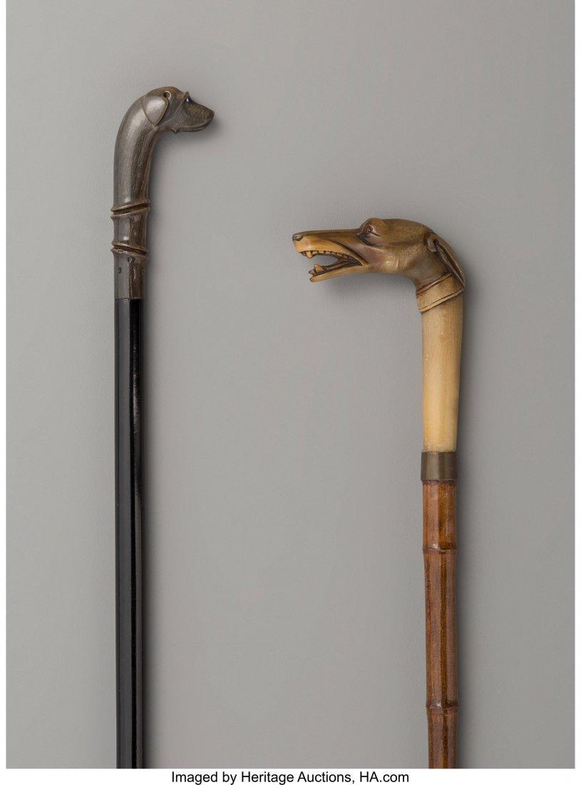 64043: Two Figural Dog Walking Sticks Maker unknown 38-