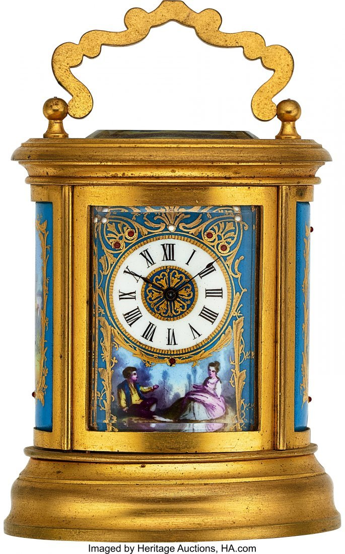54008: French, Miniature Decorative Oval Clock, circa 1