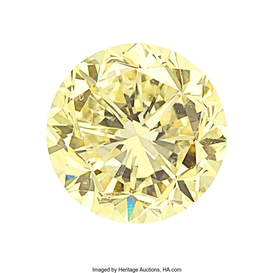 55154: Unmounted Fancy Yellow Diamond  The round brilli