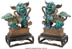 23331 A Pair of Chinese Glazed Stoneware Foo Dogs on C