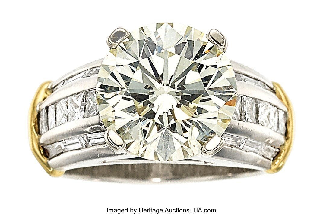 55432: Diamond, Platinum, Gold Ring  The ring features