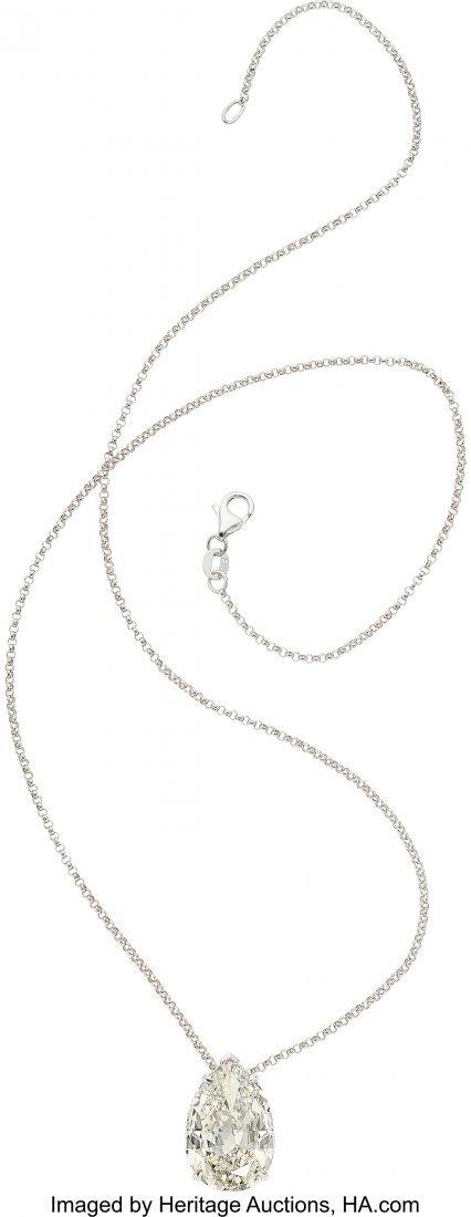 55453: Diamond, White Gold Pendant-Necklace  The pendan