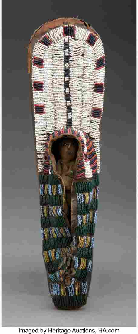 An Early Nez Perce Beaded Hide Toy Cradleboard