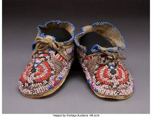 70137 A Pair of Cheyenne Childs Beaded Hide Moccasins