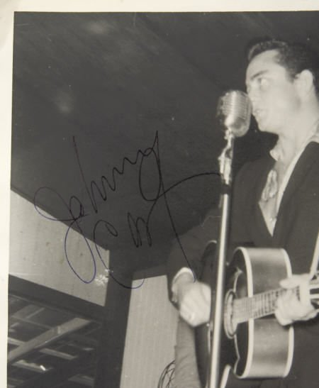 50007: Johnny Cash Signed Photo with Memorabilia.