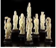 78026: A Set of Eight Chinese Pale Celadon Jade Daoist