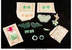 A Group of Twelve Chinese Jade Jewelry and Findi