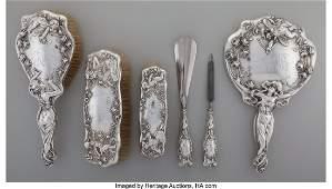27104: An American Art Nouveau Silver Vanity Set, early