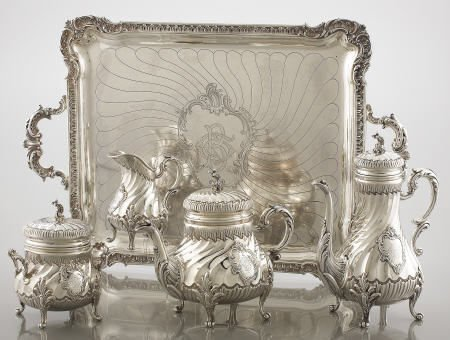 71105: A FRENCH SILVER FOUR-PIECE TEA SET AND TRAY Ferr