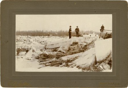 43467: Photograph: Men Standing on the Frozen Yukon Riv