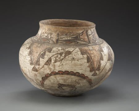 55009: A ZUNI POLYCHROME JAR c. 1880  painted in red an