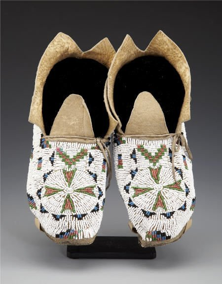 55139: A PAIR OF CHEYENNE BEADED HIDE MOCCASINS c. 1900