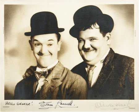 49135: Stan Laurel and Oliver Hardy Signed Photo. This