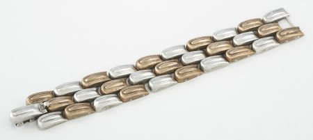 71005: A MEXICAN SILVER AND COPPER BRACELET William Spr